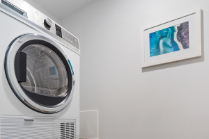 The Laundry of The Herald One Bedroom Apartment.